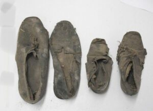 Four old shoes photo.
